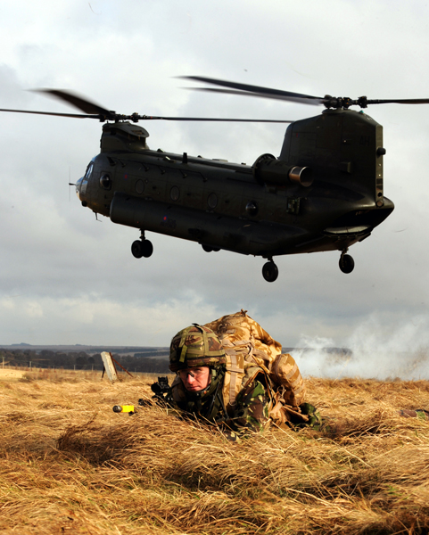 """LCpl Ross MacDougall, 1st Battalion Scots Guards, provides force protection during a CASAVAC Training Exercise during 4 Mechanized Brigade's Mission Specific Training (MST) on Salisbury Plain."""