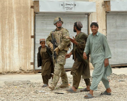 """1 Mercians patrol in Helmand in their new MTP uniforms. Note PECOC 'Hybrid DPM' Osprey armour cover."""